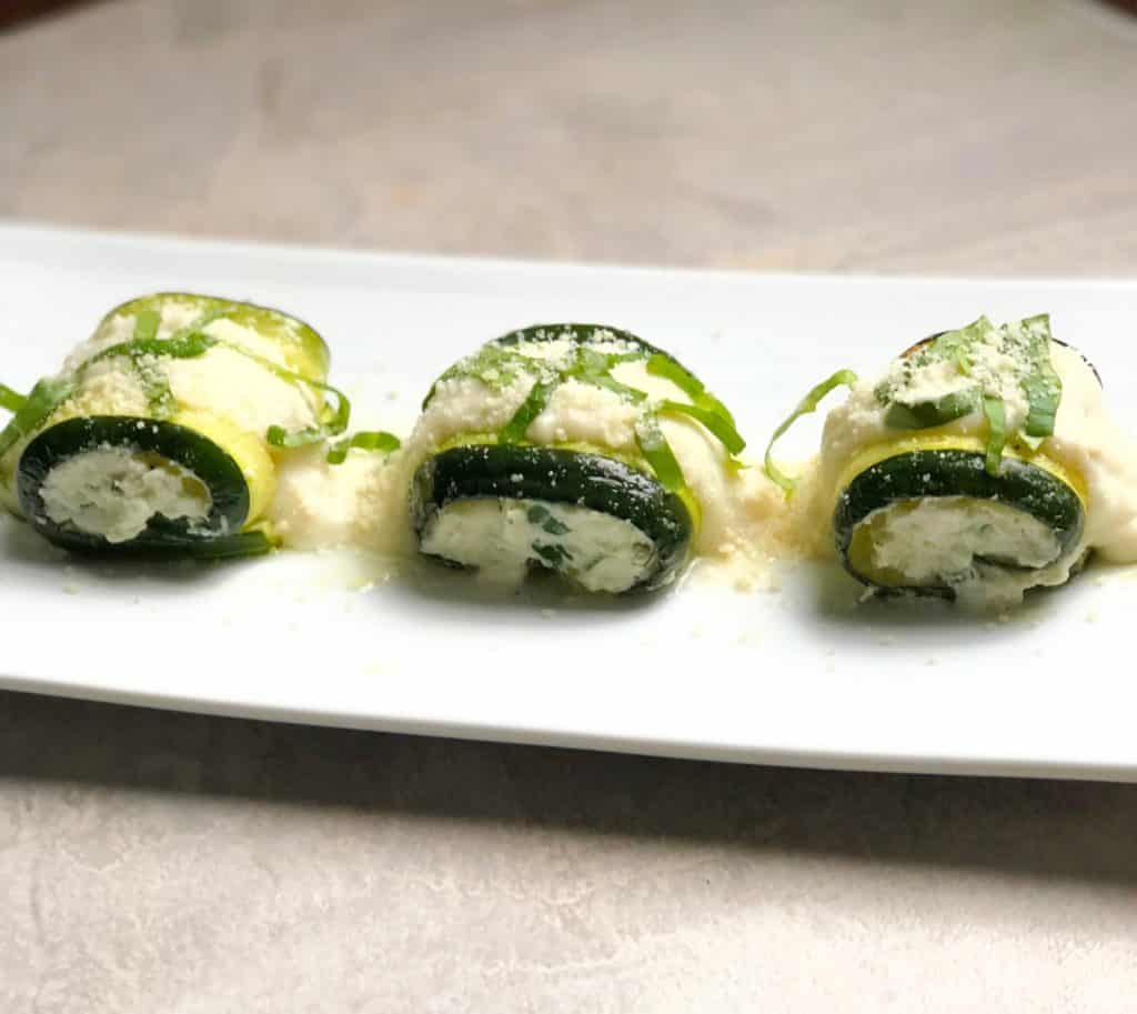 zucchini roll ups on a plate