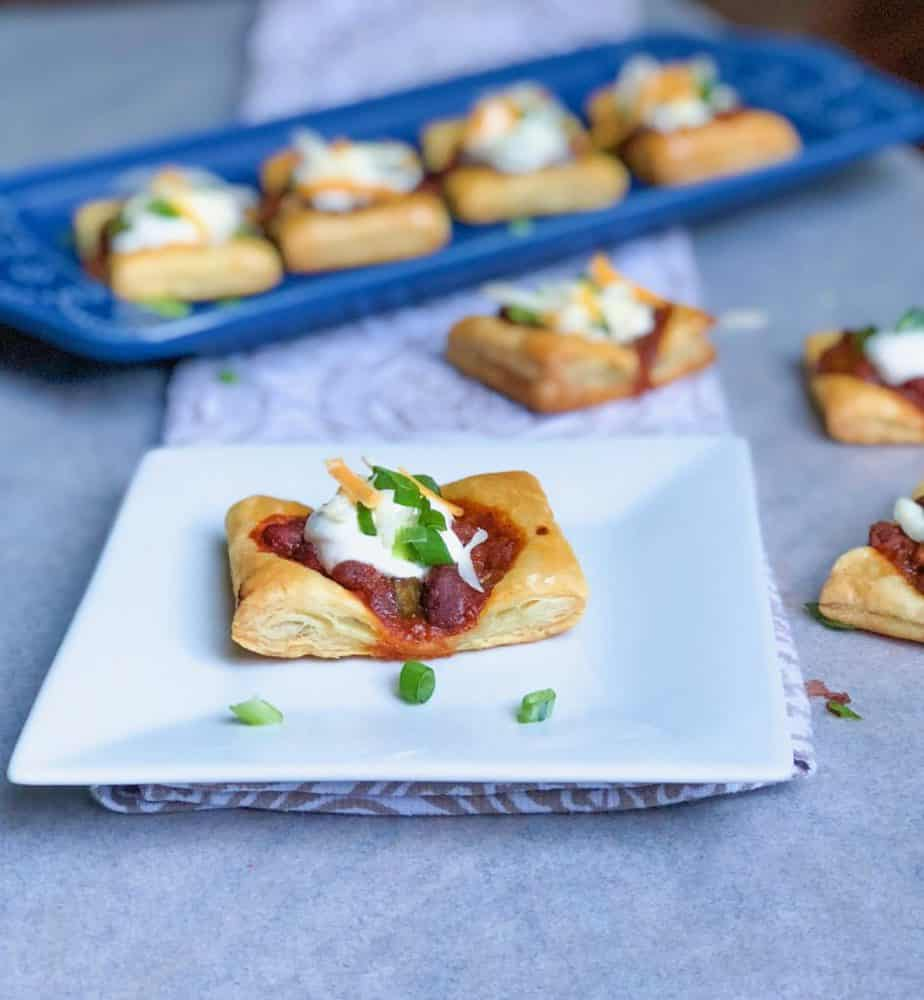 puff pastry canapes with chili and sour cream and chives