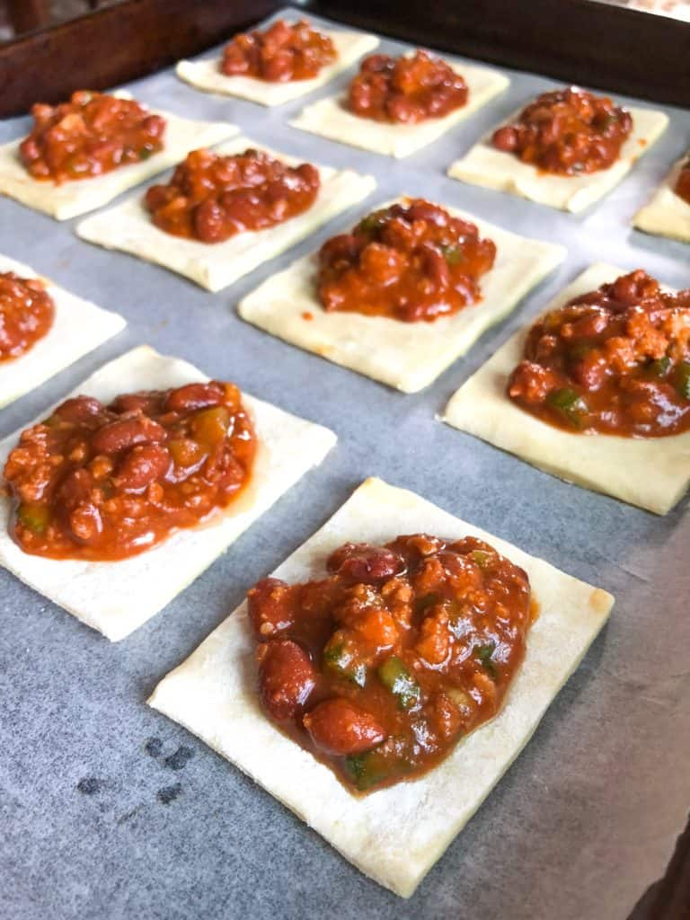 puff pastry squares topped with Hormel chili
