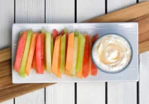 Fruit dippers or sticks served with an easy coconut Greek yogurt dip! A great healthy dessert for any party!