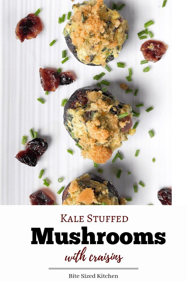 Easy cheesy stuffed mushroom appetizer with cream cheese and kale (or spinach) and craisins! They are vegetarian topped with panko breadcrumbs and chives. A delicious holiday appetizer perfect for Christmas time!
