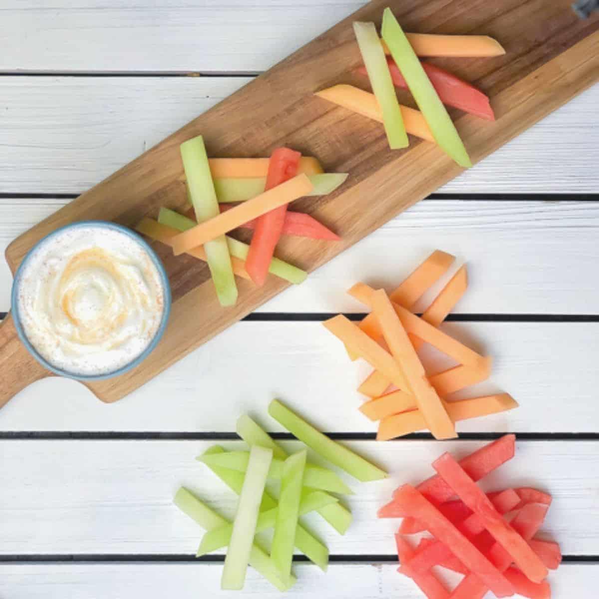 melon cut into sticks with yogurt dip