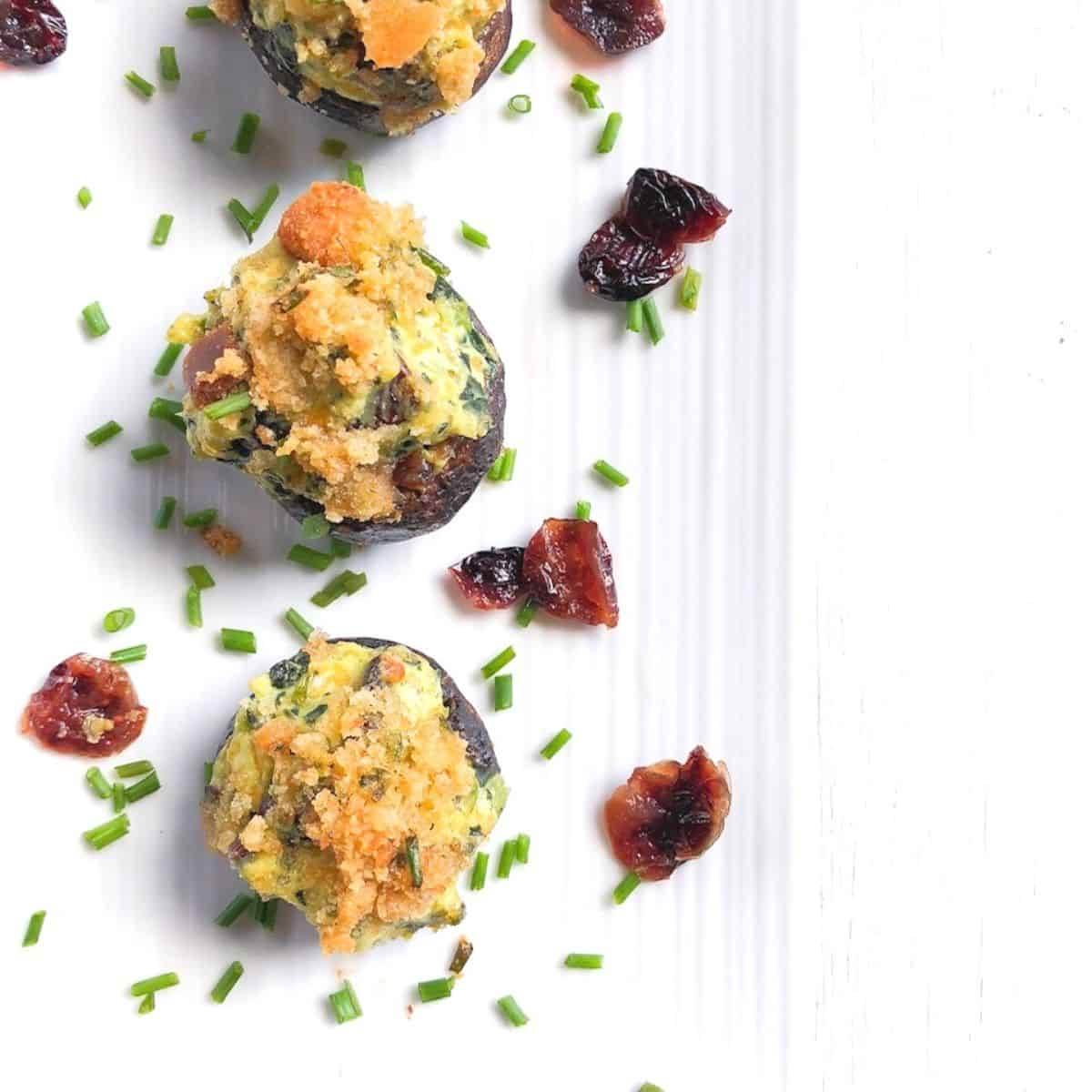 kale and cream cheese stuffed mushrooms on a plate