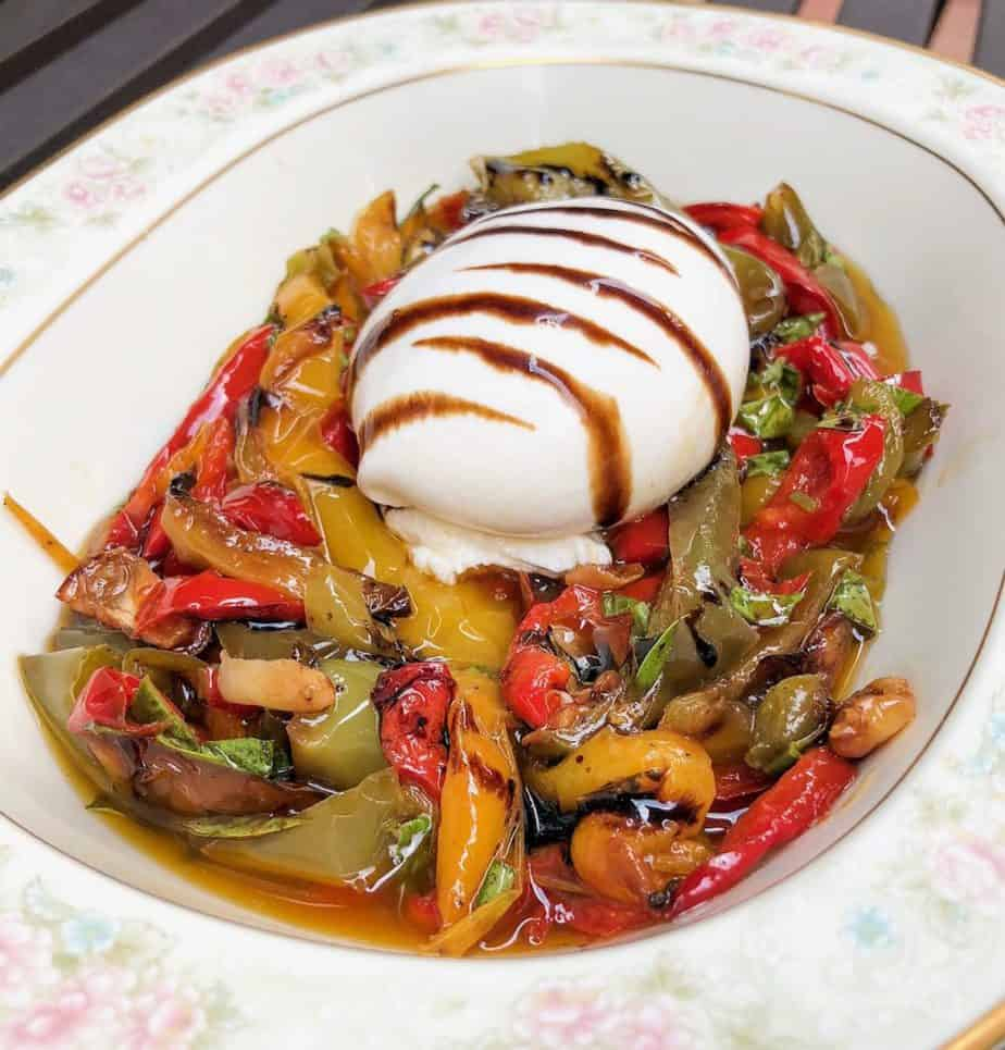 A delicious twist on a caprese salad, this easy Burrata With Roasted Peppersappetizeris my new go-to when I have last minute company! Creamy Burrata, roasted veggies finished with balsamic, this tasty vegetarian dish is served cold with warm crusty Italian bread!