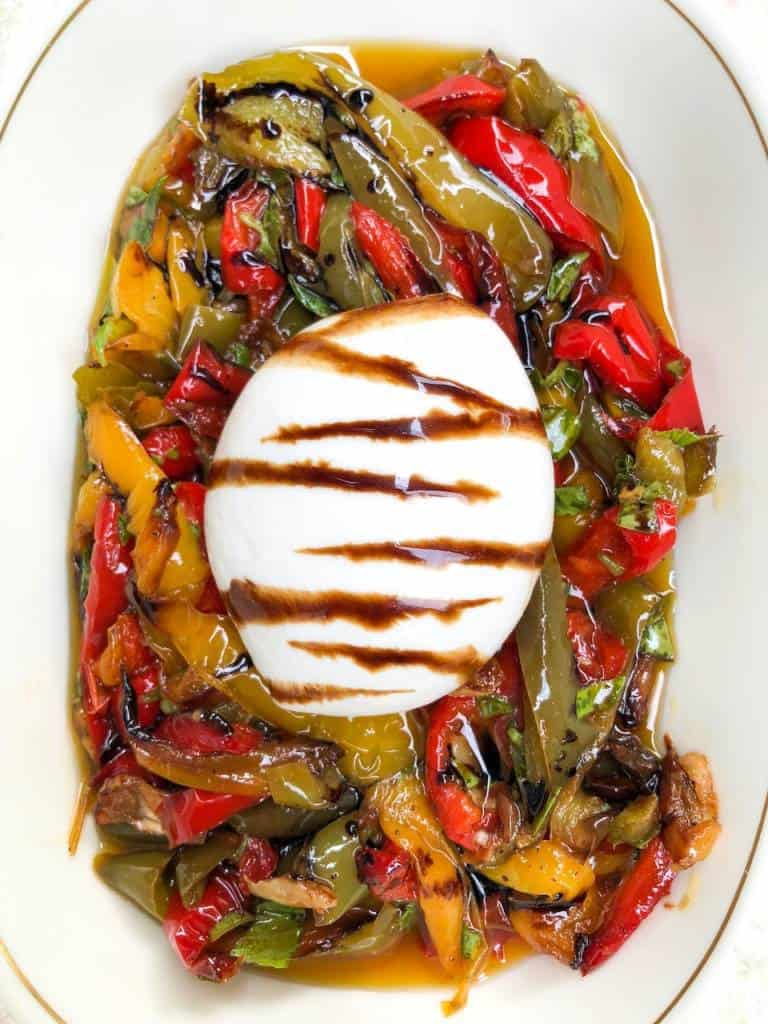 burrata cheese with cold roasted peppers and a balsamic glaze
