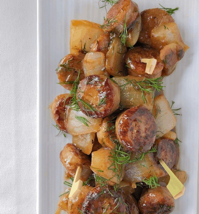 sweet chicken apple sausage on a plate with skewers