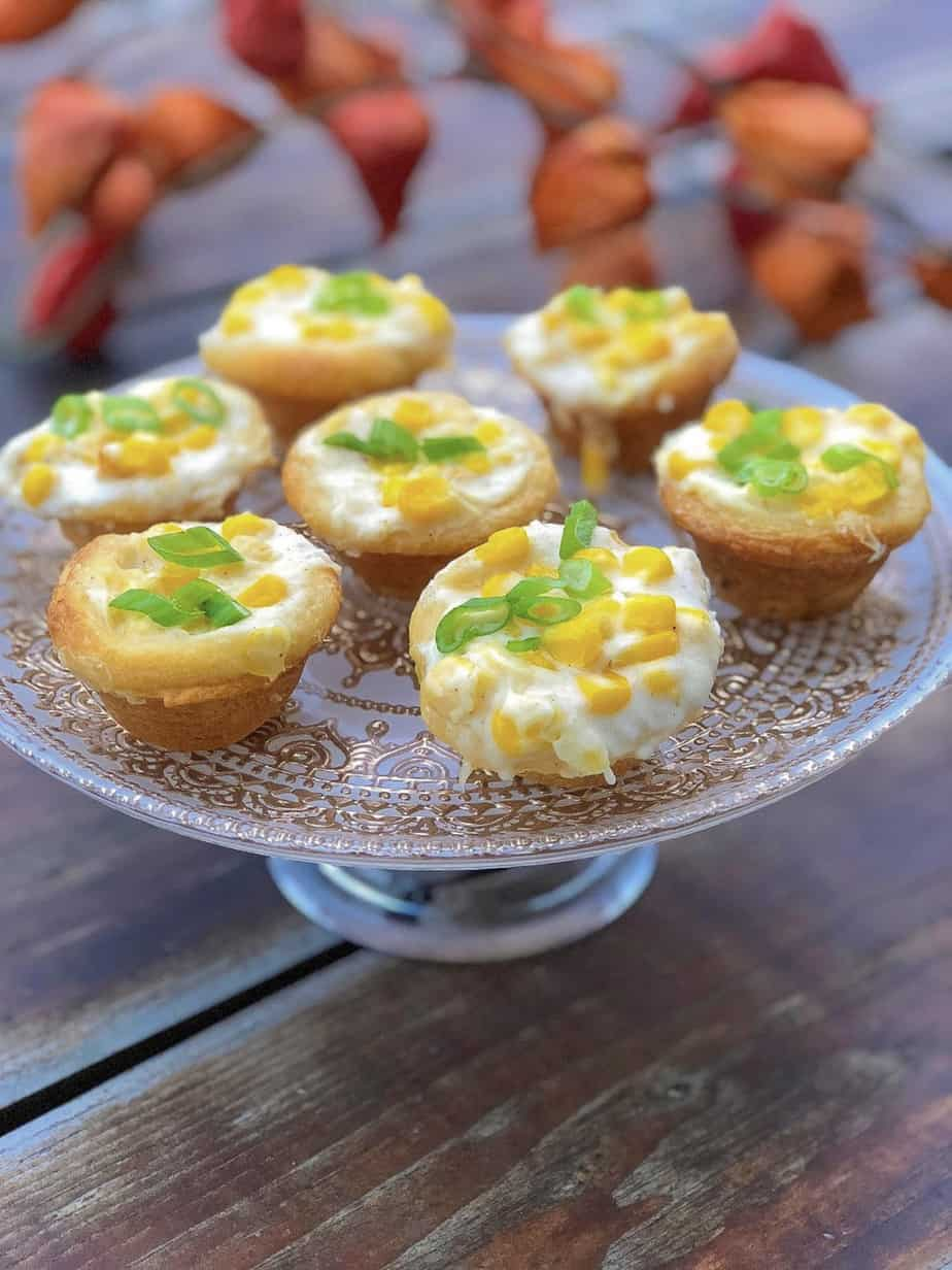 hot cream corn in biscuit cups on a plate