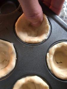 biscuit dough in muffin tin