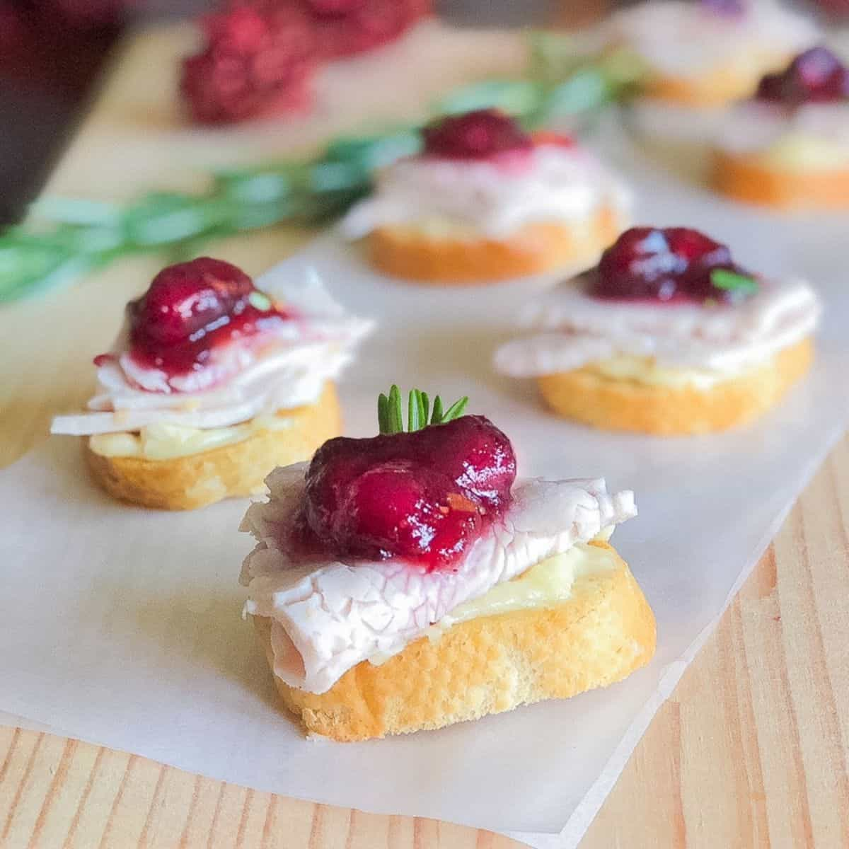 leftover Thanksgiving turkey crostini with cranberry sauce and brie cheese