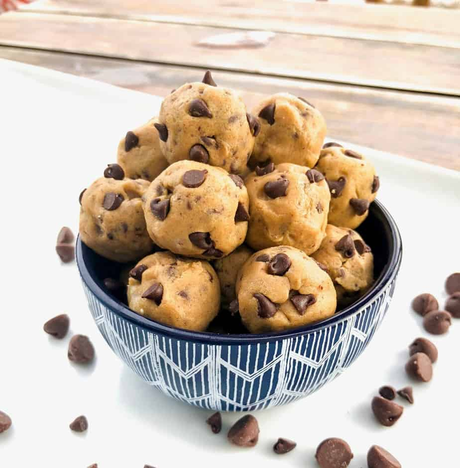mini balls of cookie dough in a bowl with chocolate chips