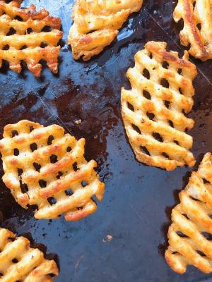 waffle fries on baking sheet