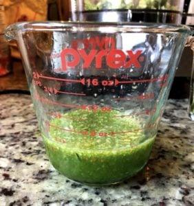 zucchini juice in a measuring cup