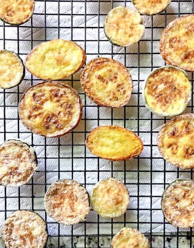 pan fried zucchini chips on a wire rack