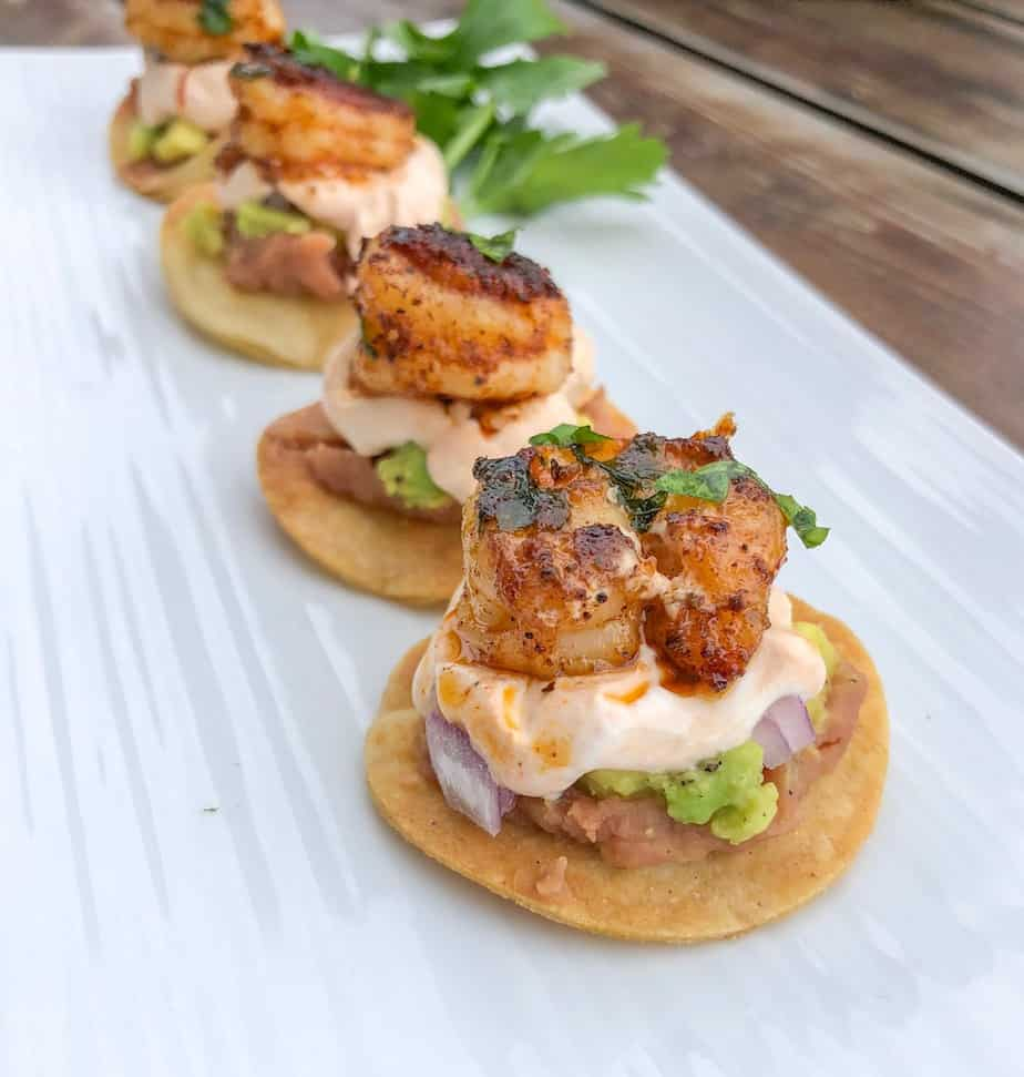 mini shrimp tostadas bites baked on a plate.
