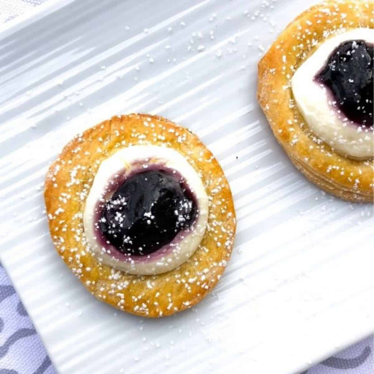 crescent dough rounds topped with sweet cream cheese and blueberries
