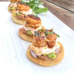 mini shrimp tostadas bites lined on a plate