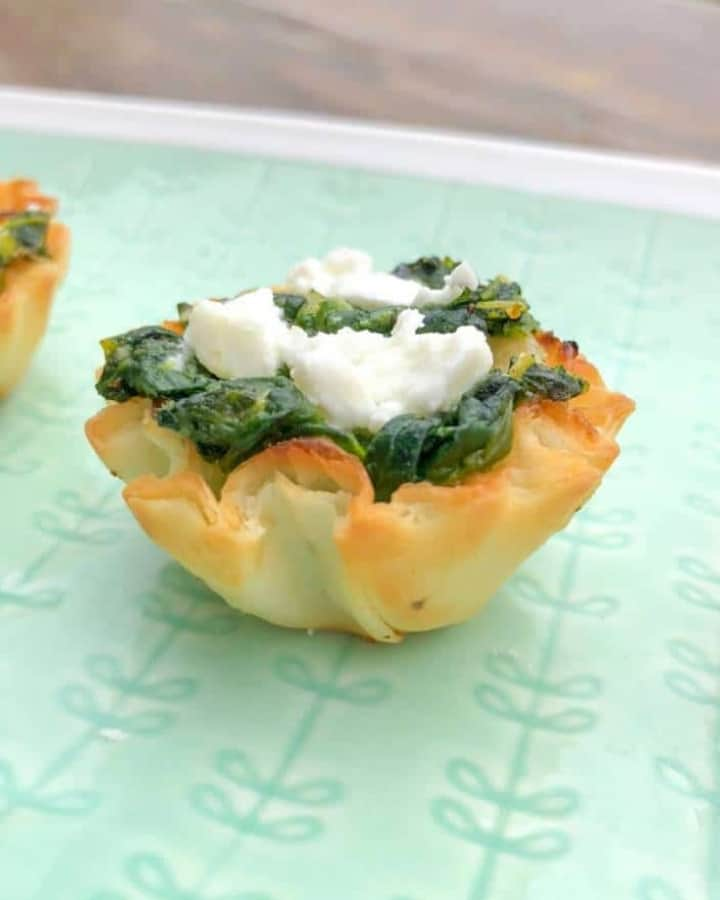 spinach and feta phyllo shell appetizer on a plate