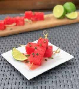 Boozy Watermelon Mojito Skewers on a plate