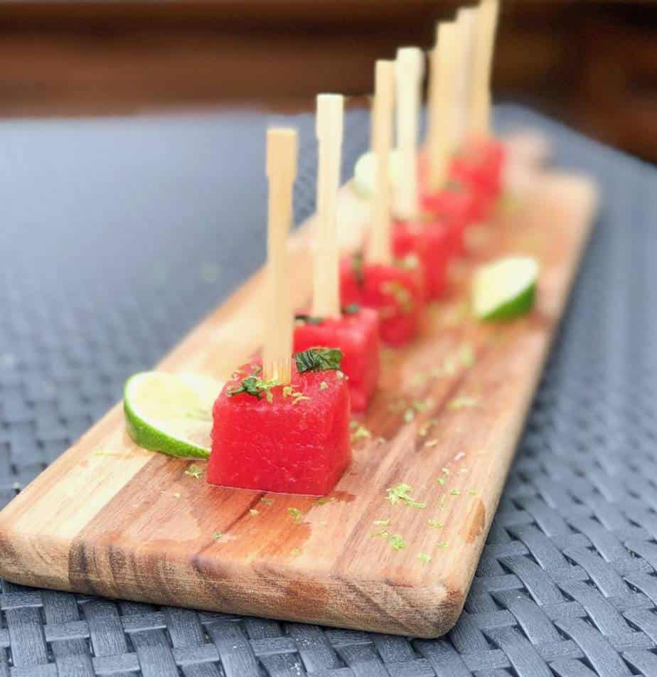 watermelon mojito skewers appetizer on a wooden plank.