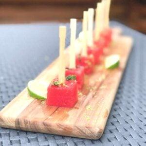 watermelon skewers on a wooden board