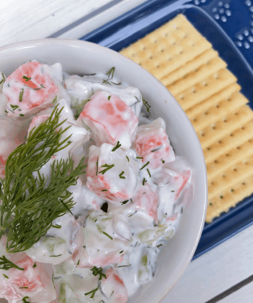 Healthy Imitation Crab Salad with lemon and dill in a bowl.