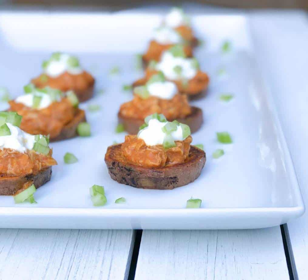 sweet potato rounds topped with buffalo chicken and sour cream.