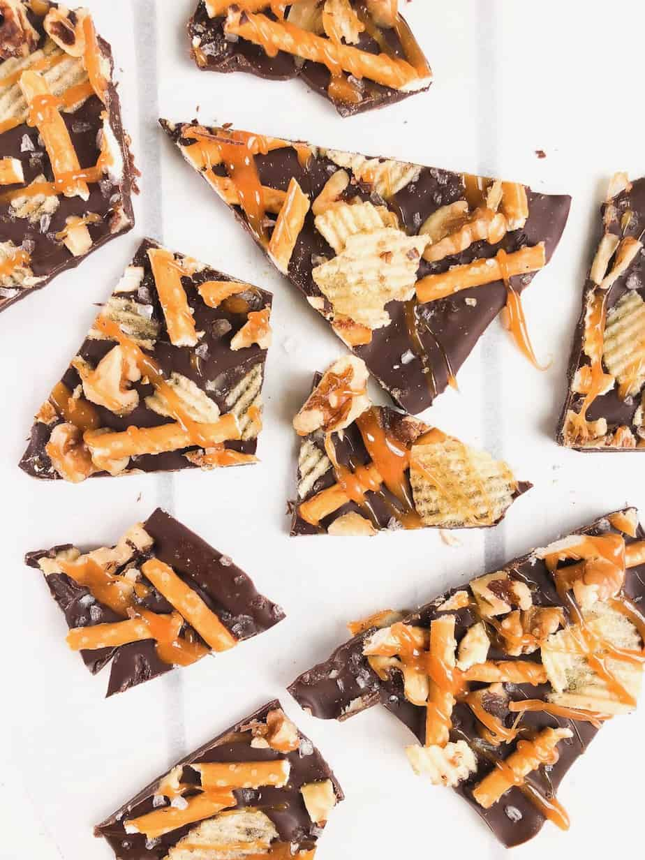 An Awesome Healthy Dark Chocolate Salted Bark Recipe! This bark is made with pretzels, nuts, potato chips and sea salt. Drizzle with caramel for an extra sweet touch! A perfect treat for Christmas or Halloween parties! Can be kept in the freezer for long storage too!