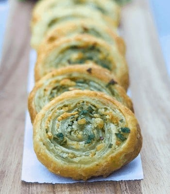 puff pastry pinwheels on cutting board.
