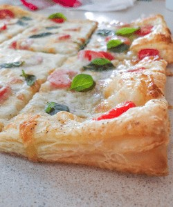 An easy savory puff pastry pizza appetizer recipe! So many ideas when using Pepperidge Farms puff refrigerated puff pastry dough!