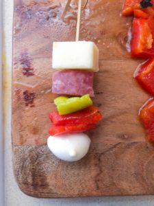 cheese, salami and peppers on a skewer
