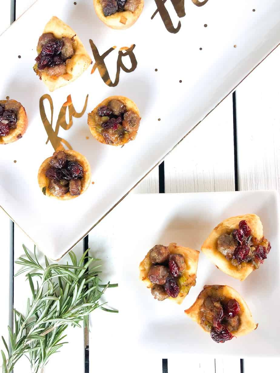 These festive Christmas Stuffing Cups are an easy finger foods party appetizer! Of all your recipes, this will be your go-to appetizer for a crowd that is both elegant and cute!