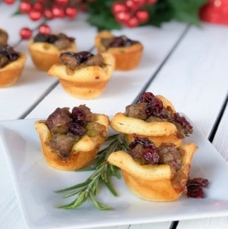 christmas stuffing cups with sausage and craisins on a plate