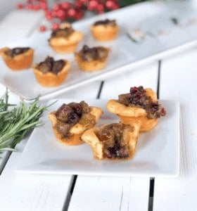 Christmas Stuffing Cups with sausage and crasins on a plate