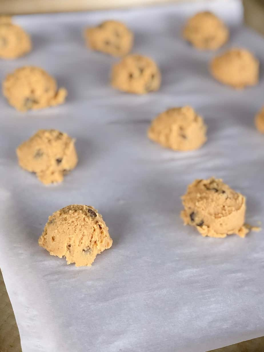 Easy soft chocolate chip pudding cookies raw on baking sheet.
