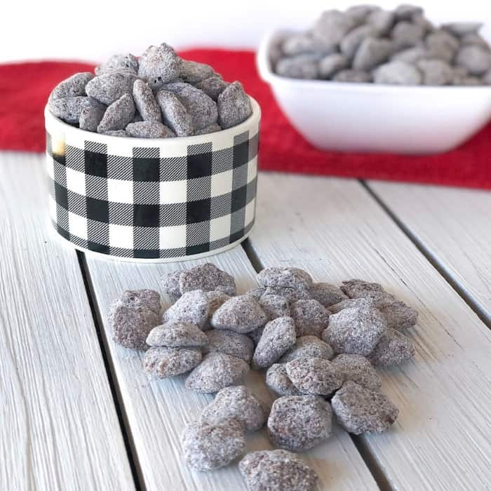 Easy muddy buddies or puppy chow recipe made without peanut butter! Chocolate, pudding mix and chex mix makes these the BEST recipe!! #muddybuddies #puppychow #scankfood #partysnacks