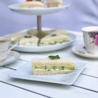 Simple but elegant English tea sandwiches ideal for a crowd or afternoon brunch party. Three recipes that have vegetarian fillings. How to display and how to cut your cucumber sandwiches. #fingerfood #teasandwich #teaparty #fancy #brunch