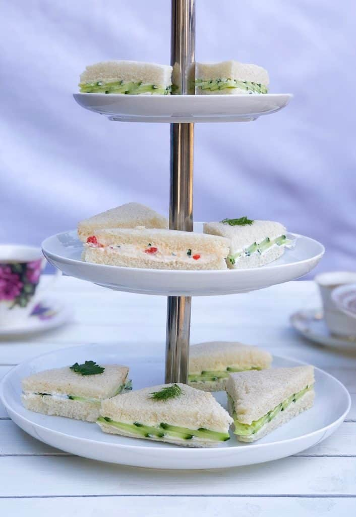 These easy English tea sandwiches are a simple but elegant way to serve cucumber sandwiches. They are perfect for a baby or bridal shower party! The fillings are all vegetarian made with cream cheese, pimento peppers and Greek yogurt dill. #teasandwiches #cucumber #teaparty #babyshower #bridalshower #fingersandwiches