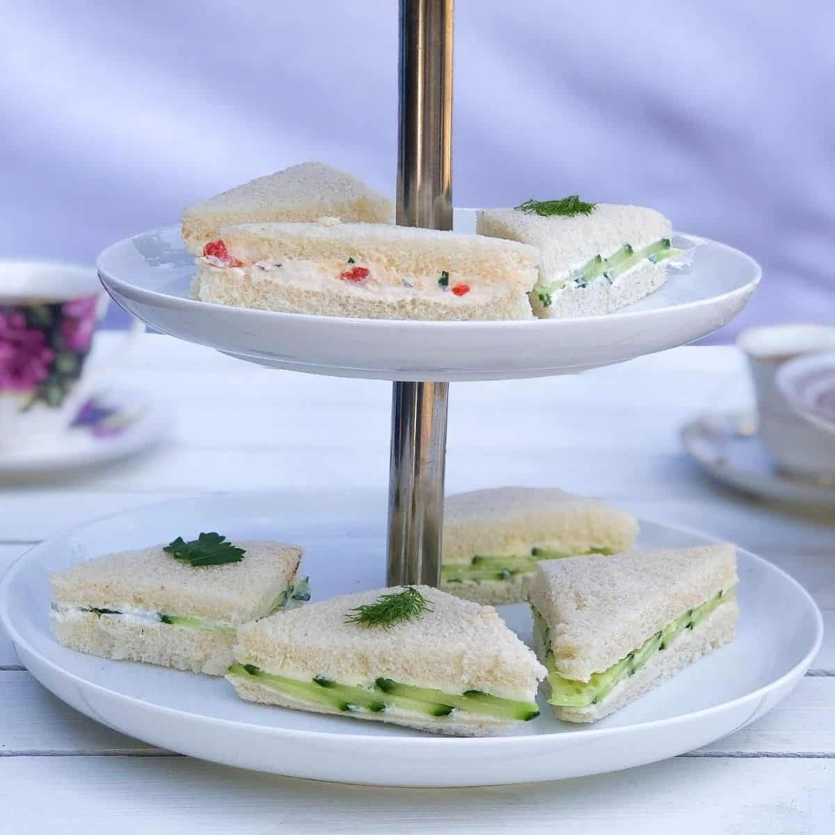 Tiered serving platter with English tea finger sandwiches.