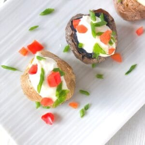 Mini baked potatoes stuffed with sour cream.