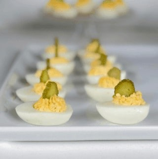 An easy classic deviled eggs recipes that is not runny! They have dill pickles and worcestershire for added flavor. #appetizer #eggs #pickles #easy