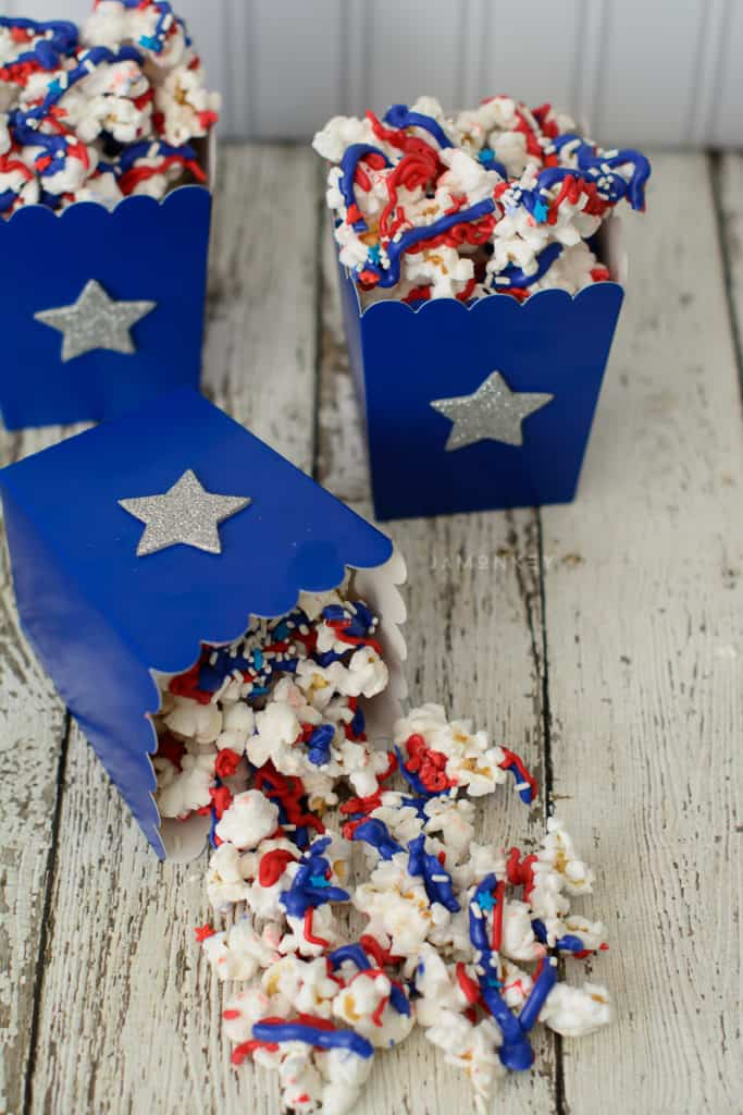 Red white and blue popcorn spilled on table.