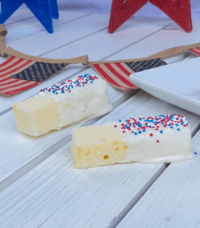 Cake sticks dipped in white chocolate sprinkled with red, white and blue nonpareils.