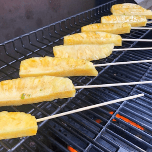 Pineapple spears grilling on the grill.