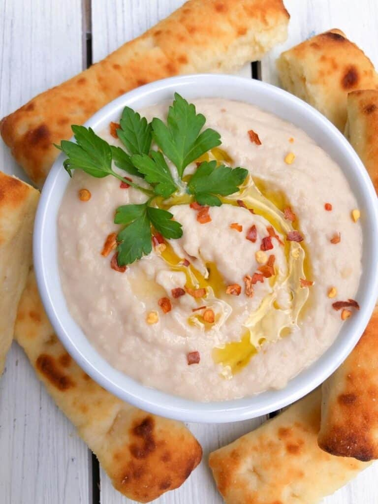 White bean dip in a bowl with olive oil.