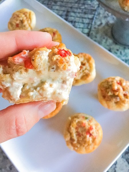 Biscuit stuffed jalapeno and sausage bites! These biscuit bombs are a delicious and easy appetizer to serve especially at your football party or tailgate!