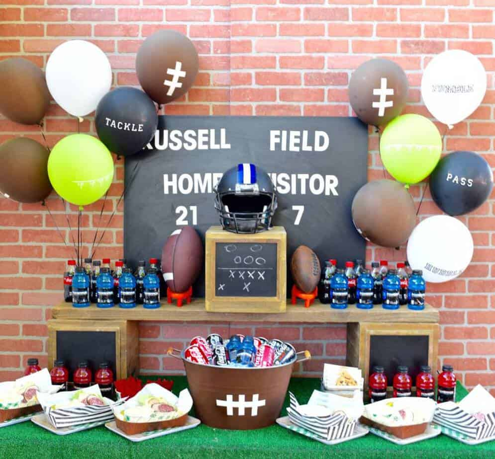 Football party table set up with balloons.