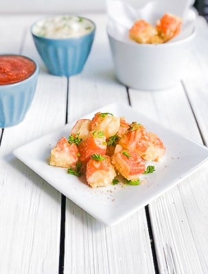 Easy fried crab stick bites made with imitation crab meat on a plate.