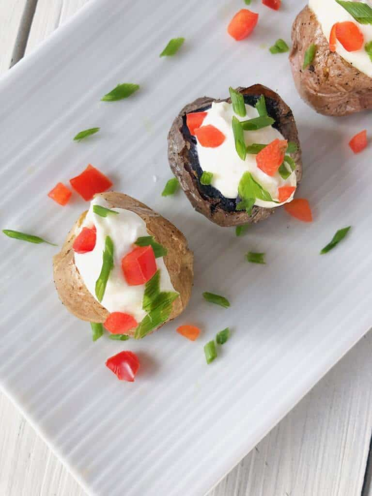 mini baked potatoes on a plate for any party.