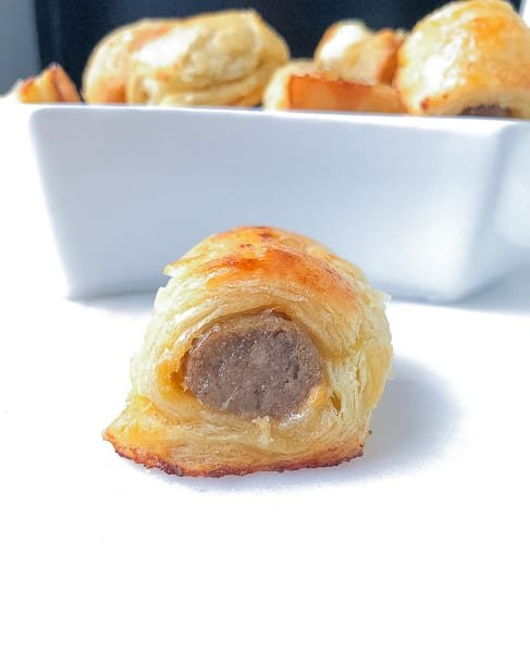 Puff pastry breakfast sausage pigs in a blanket. A great appetizer for football parties!