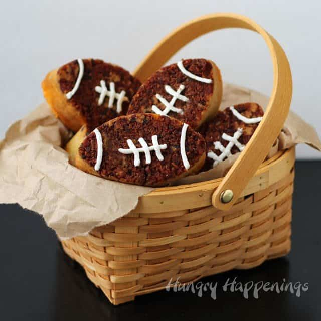 bacon cheddar beer bread shaped into footballs in a basket.